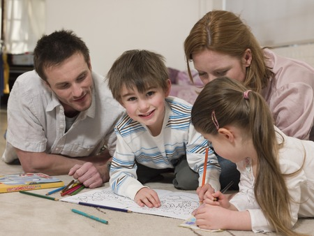 human relations: Parents on Floor Coloring With Children LANG_EVOIMAGES