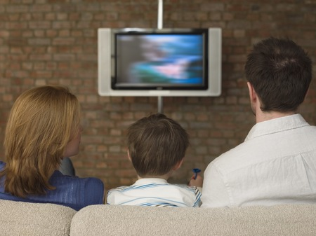 late 30s: Boy Between Parents Watching Television