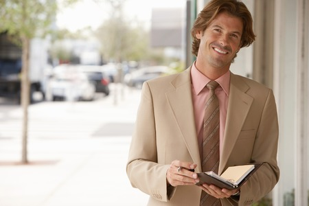 Businessman with Daily Planner Stock Photo - 5478476