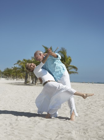 only mature women: Couple Dancing on the Beach