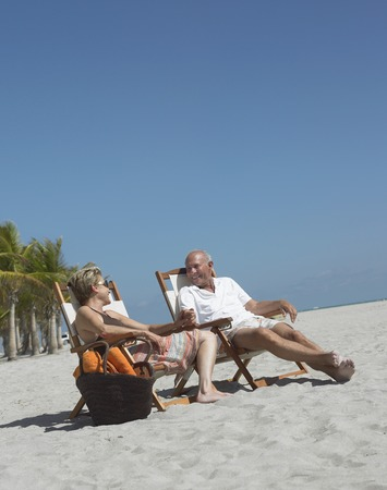 deckchair: Mature Couple on Beach
