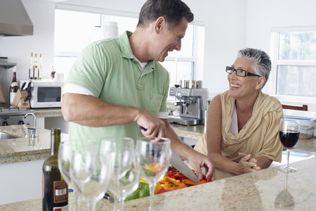 Couple Chatting While Preparing Food Stock Photo - 5478661