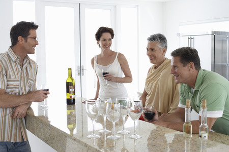 living being: Parents Enjoying Wine with Grown Children