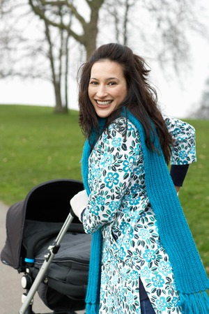 Mother with Stroller on a Walk