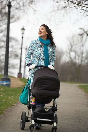early twenties: Mother with Stroller on a Walk