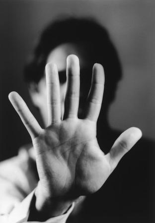apathetic: Hand Blocking Mans Face