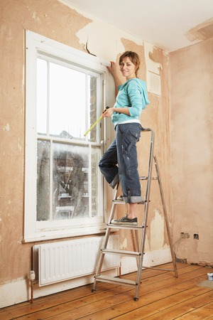 beforehand: Woman Preparing to Renovate Room LANG_EVOIMAGES