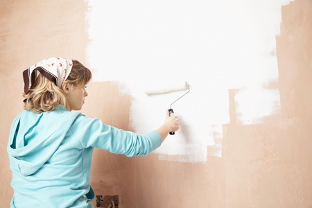 late 30s: Woman Painting Wall with Roller