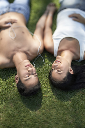 Couple on Lawn Listening to Music Together Stock Photo - 5487523