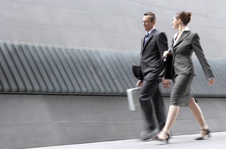 hurrying: Businesspeople Walking Side by Side LANG_EVOIMAGES