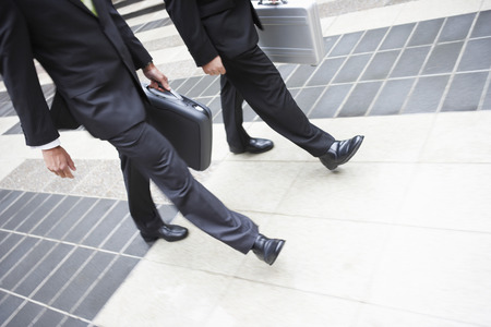 Two Businessmen with Briefcases Stock Photo - 5487539