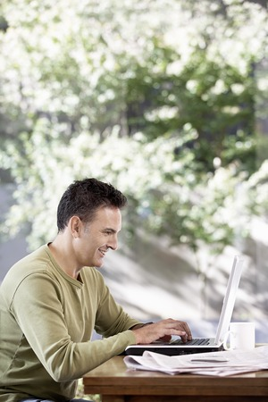 lap top: Man Using a Laptop Outside LANG_EVOIMAGES