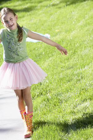 grass skirt: Young Girl Playing Outside