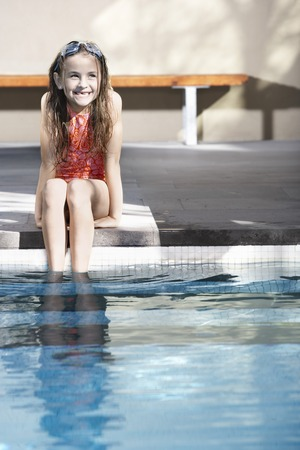 Young Girl Sitting By the Pool Stock Photo - 5438238