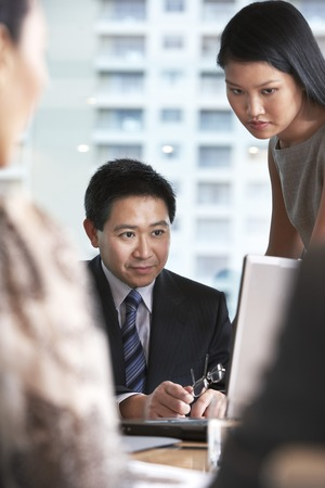 Businesspeople Looking at Laptop Screen Stock Photo - 5436064