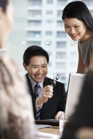 accomplishing: Businesspeople Using Laptop