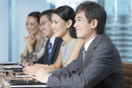 asian business people: Businesspeople in Conference Room LANG_EVOIMAGES