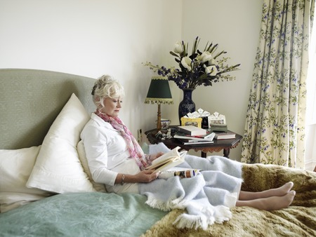 Senior Woman Relaxing with a Book Stock Photo - 5436079