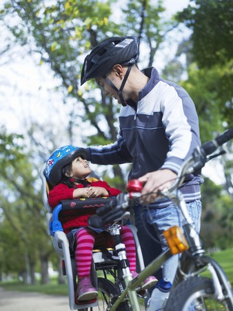 Father and Daughter on Bike Ride Stock Photo - 5436088