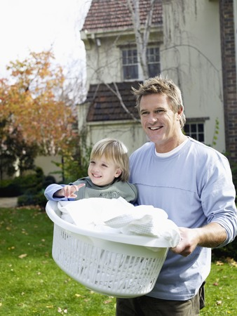 role reversal: Father Carrying Son in Laundry Basket