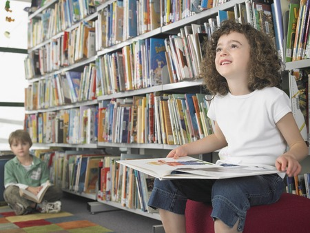 being the case: Elementary Student Reading in Library
