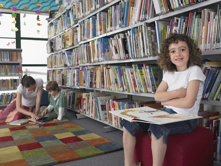 elementary students: Elementary Student Reading in Library