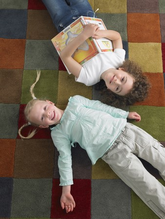 lay down: Two Elementary Students LANG_EVOIMAGES
