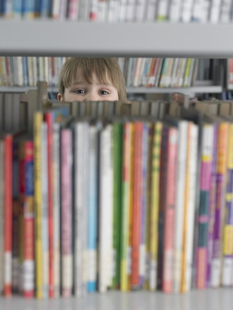 Elementary Student Reading in Library Archivio Fotografico - 5487579