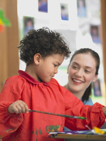 Elementary Student and Teacher in Art Class