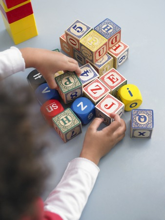 Elementary Student Playing With Building Blocks Stock Photo - 5487582