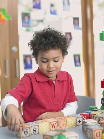 Elementary Student Playing With Building Blocks Stock Photo - 5487583