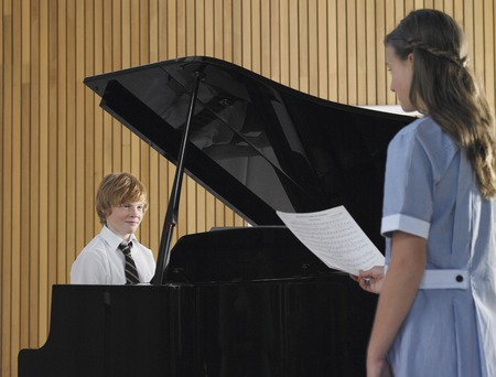 grand child: Two High School Students in Music Class