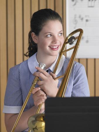 trombone: High School Student Practicing Trombone