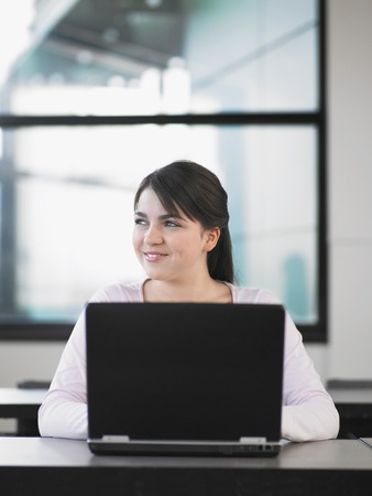 Teenager Using a Laptop Stock Photo - 5487607
