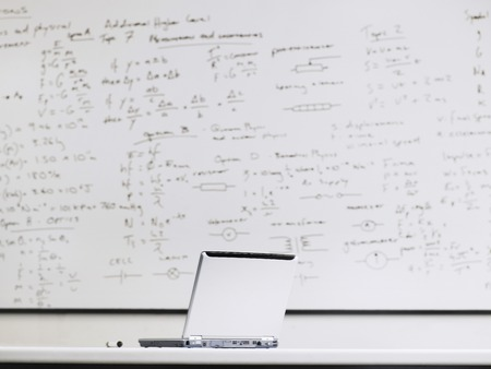 dry erase board: Laptop in Mathematics Class
