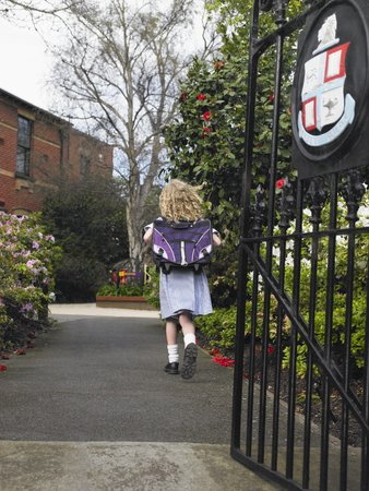 private schools: Girl Walking to School LANG_EVOIMAGES