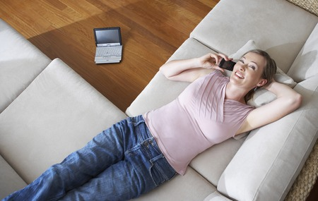 hooked up: Woman Relaxing on Couch