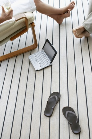 Couple Relaxing on Porch Stock Photo - 5487644