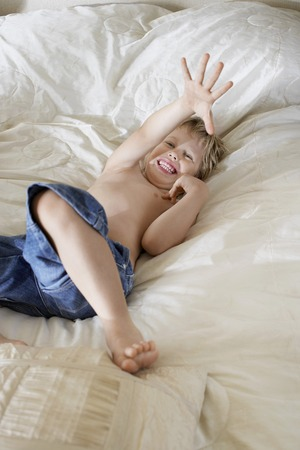 Boy Playing in Bed Stock Photo - 5487649