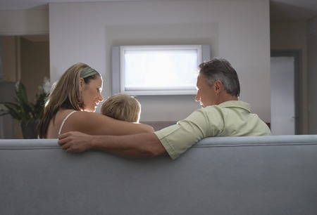 Parents Watching TV with Son Stock Photo - 5487656