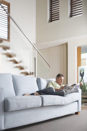 livingrooms: Man Reading Newspaper LANG_EVOIMAGES