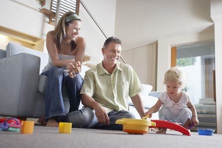 Parents Playing with Son Stock Photo - 5487659