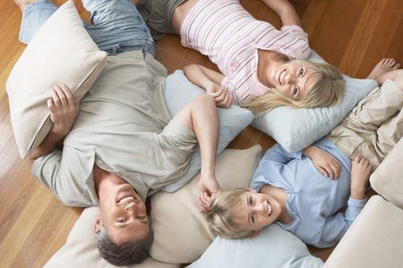Father and Children Lying on Floor Stock Photo - 5487670