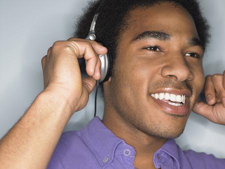 no kw 1: Man Listening to Headphones