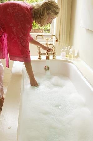 bathwater: Woman Preparing Bubble Bath