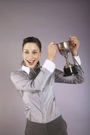 early thirties: Businesswoman Holding Trophy