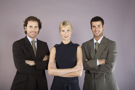 folding arms: Businesspeople Standing Together