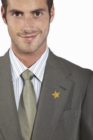 fervour: Businessman with Gold Star on Suit