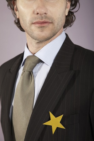 Businessman with Gold Star on Suit