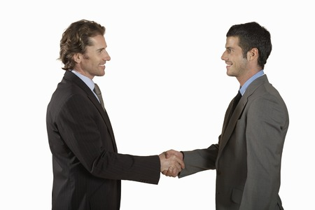 early thirties: Businessmen Shaking Hands LANG_EVOIMAGES